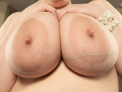 Chubby black-haired girl with huge tits and areolas