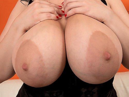 Busty Black-haired girl in black lingerie