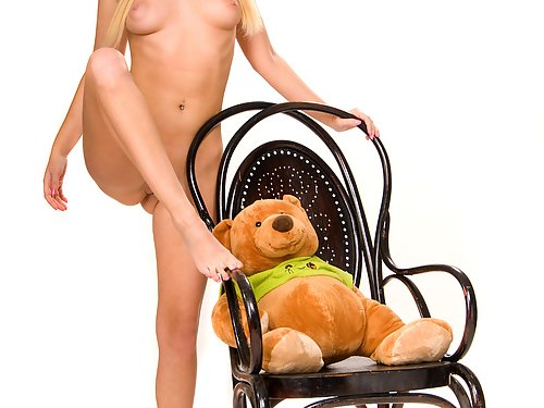 Blonde teen posing with her teddy bear
