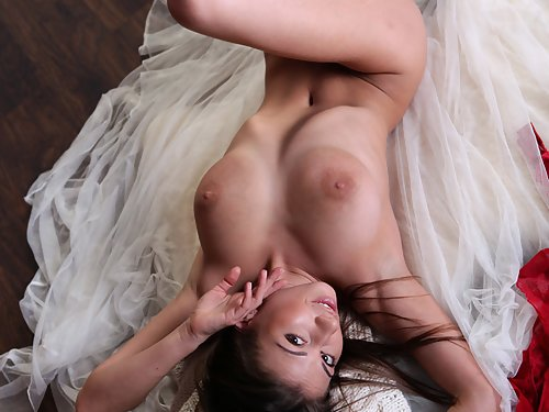 Brunette with big veiny tits posing