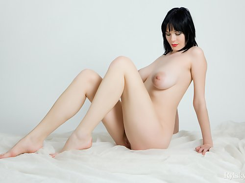 Busty and hairy black-haired girl with huge areolas