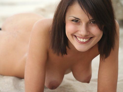 Brunette with big areolas at the beach