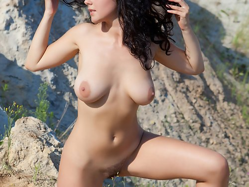 Busty brunette with big areolas nude at the beach