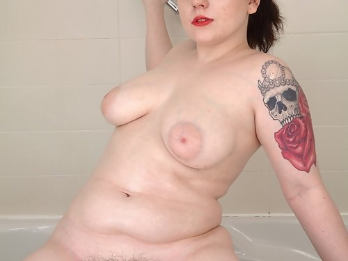 Chubby brunette with pale skin spreads her hairy pussy in the bathtub