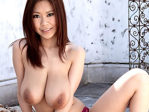 Asian schoolgirl shows off her huge titties