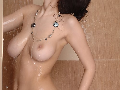 Busty brunette showering