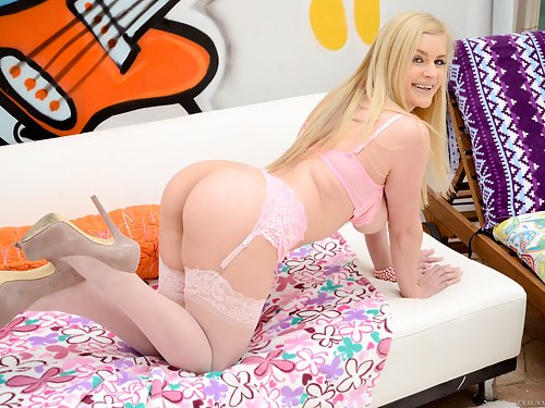 Busty blonde spreads her big ass