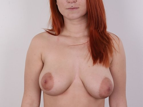 Casting pics of a freckled redhead with big natural tits