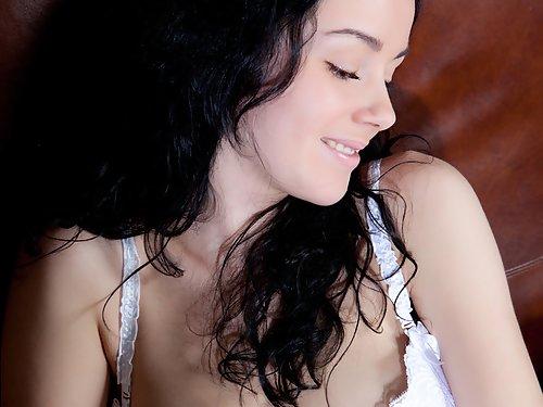 Busty black-haired hottie in lingerie