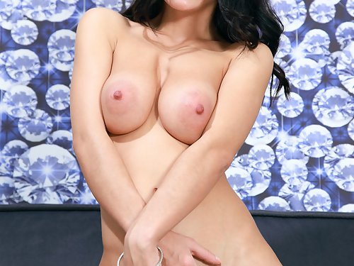 Busty black-haired hottie with huge pussy lips