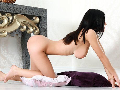 Busty black-haired babe with huge pussy lips