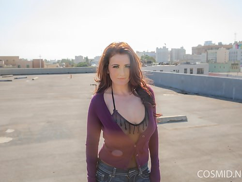 Busty redhead in a sheer bodysuit stripping