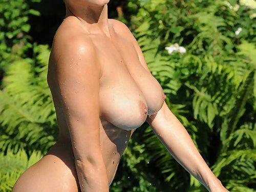 Busty blonde hottie nude in a pool