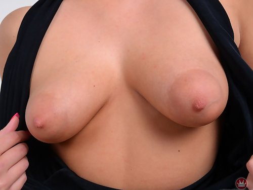 Blonde with puffy nipples spreads her holes