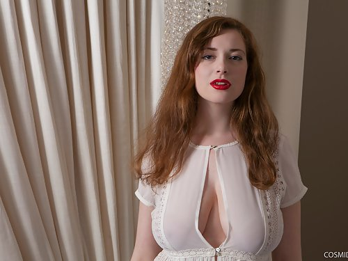 Chubby redhead with huge tits and large areolas stripping