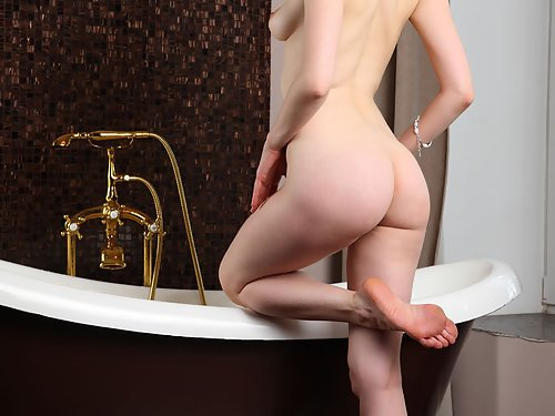 Hairy redhead with pale skin nude in the bathtub