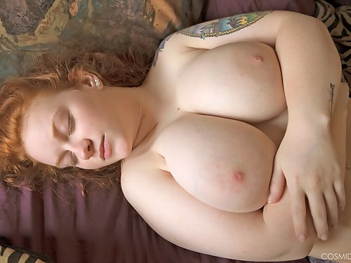 Chubby redhead with big tits posing nude