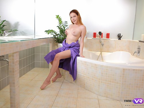 Redhead with large areolas masturbating in the bathtub