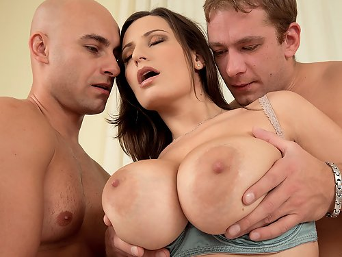 Busty brunette getting fucked by 2 guys