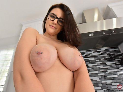 Nerdy busty brunette spreads her holes