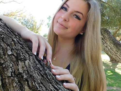 Chubby busty blonde flashing in a park