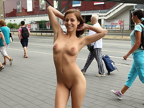 Busty brunette with large areolas nude in public