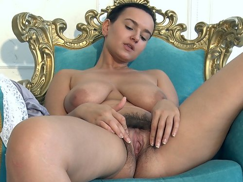 Busty black-haired girl Ramira spreads her hairy pussy