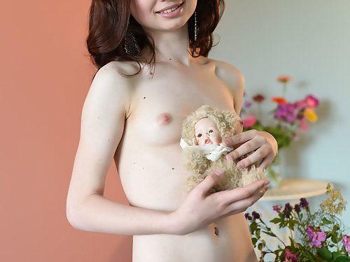 Petite teen cutie with small tits posing nude