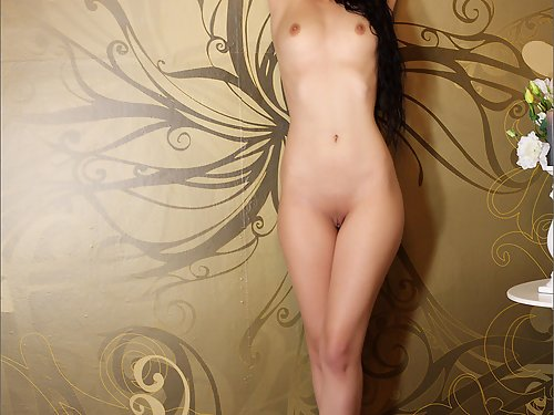 Black-haired girl spreading in her bedroom