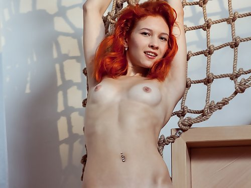 Shaved redhead rubs her big pussy lips