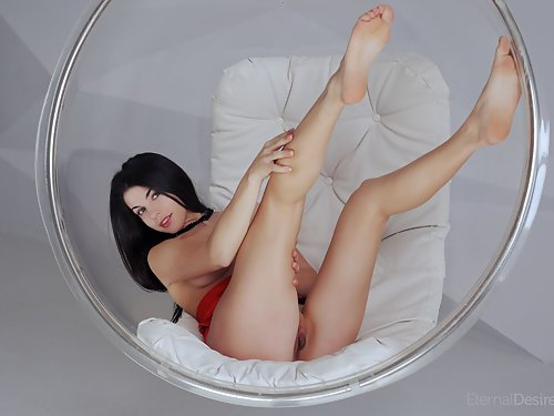 Black-haired hottie spreads her big pussy lips