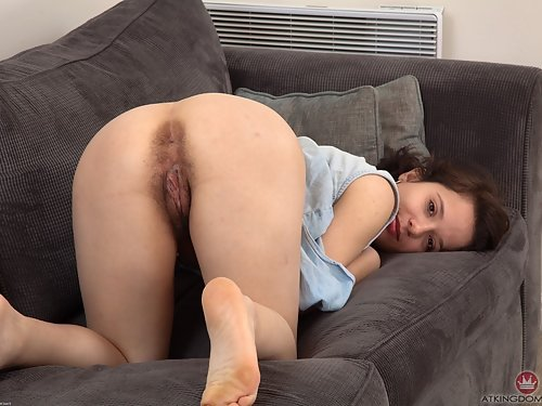 Busty brunette spreads her wet hairy pussy