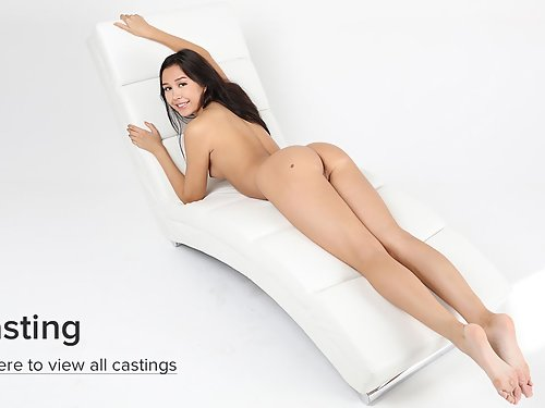 Shaved brunette Li Moon stripping and masturbating
