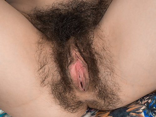 Black-haired amateur spreads her hairy holes