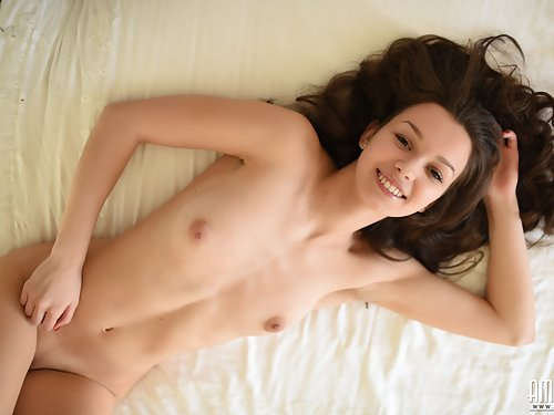Lovely brunette spreading in bed
