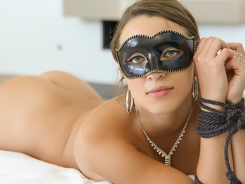 Tied-up babe gets cum on her mask