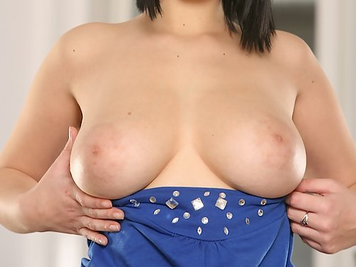 Black-haired amateur with huge tits and areolas