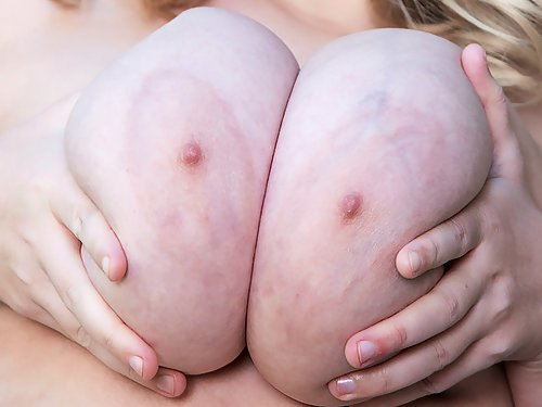 Chubby hairy blonde shows off her huge tits