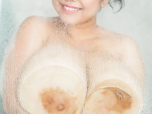 Chubby and busty Asian showering
