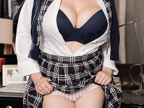 Brunette schoolgirl shows off her huge tits