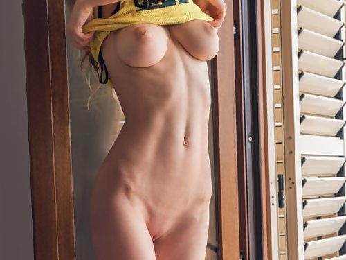 Skinny busty brunette spreading on the balcony