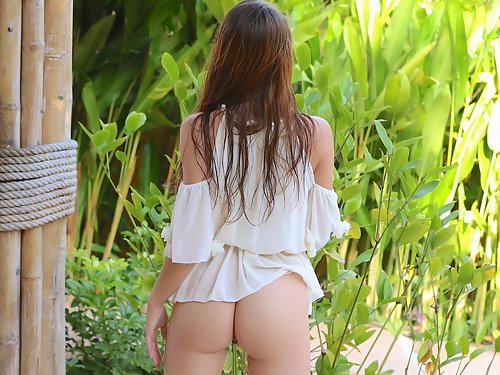 Sexy brunette babe stripping in her backyard