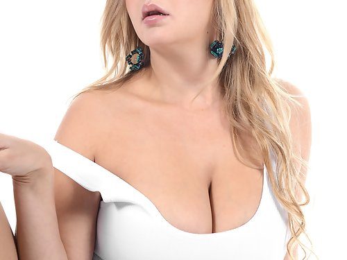 Busty blonde toying her shaved pussy