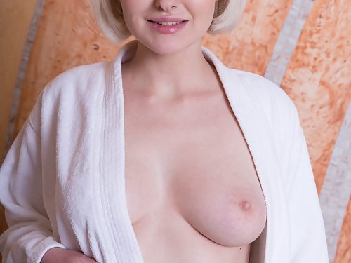 Shaved blonde with large areolas bathing