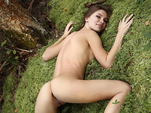 Sexy Russian brunette with big pussy lips nude in a forest