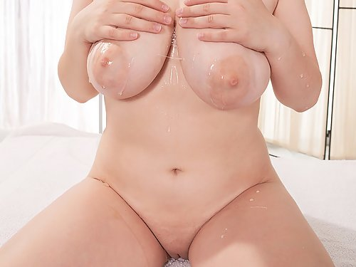 Chubby brunette with big tits toying