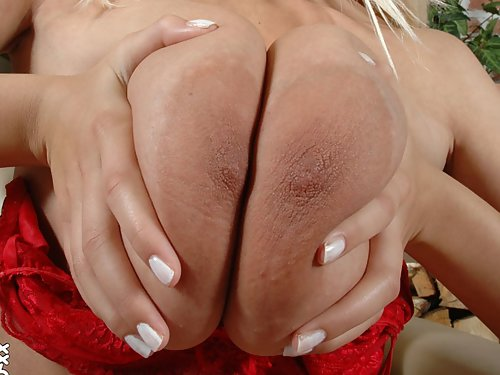 Shaved blonde shows off her huge areolas