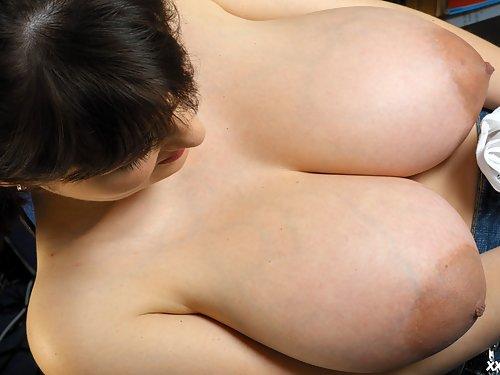 Sexy brunette Lorna Morgan measures her big tits