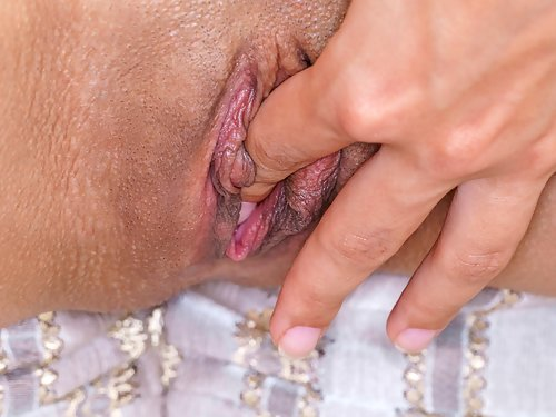 Brunette with meaty pussy lips masturbating