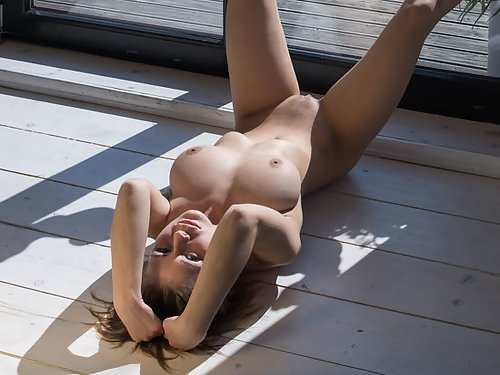 Busty girl with large pussy lips nude on the balcony
